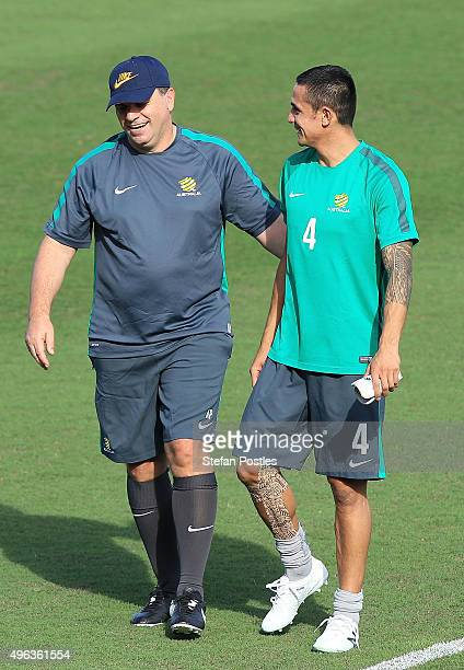 Socceroos Coach Ange Postecoglou and Tim Cahill speak during a Australian Socceroos training session at GIO Stadium on November 9 2015 in Canberra...