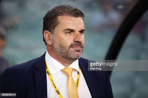 Socceroos coach Ange Postecoglou looks on during the national anthems during the 2018 FIFA World Cup Qualifier match between the Australian Socceroos...