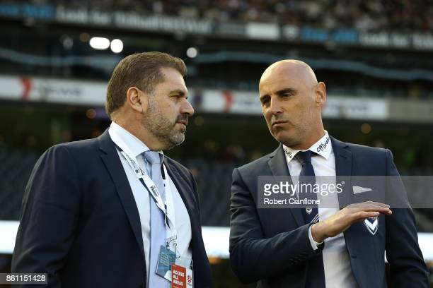 Socceroos coach Ange Postecoglou speaks with Victory coach Kevin Muscat prior to the round two ALeague match between Melbourne Victory and Melbourne...