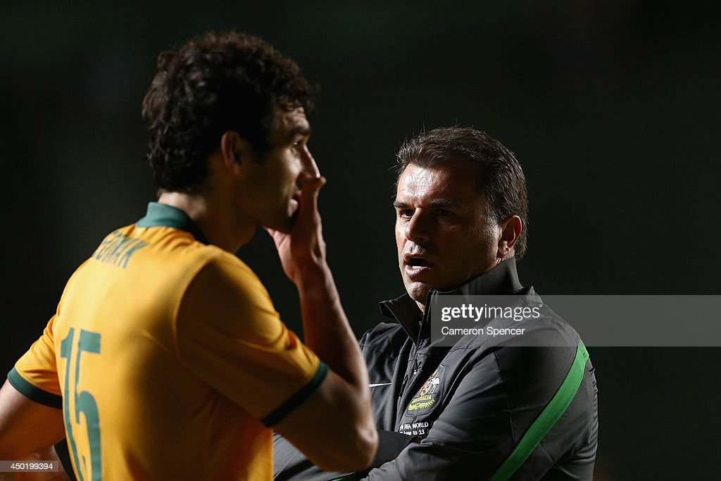 Socceroos coach <a gi-track='captionPersonalityLinkClicked' href=/galleries/search?phrase=Ange+Postecoglou&family=editorial&specificpeople=3395755 ng-click='$event.stopPropagation()'>Ange Postecoglou</a> talks to Socceroos captain <a gi-track='captionPersonalityLinkClicked' href=/galleries/search?phrase=Mile+Jedinak&family=editorial&specificpeople=3123629 ng-click='$event.stopPropagation()'>Mile Jedinak</a> following the International Friendly match between Croatia and the Australian Socceroos at Pituacu Stadium on June 6, 2014 in Salvador, Brazil.