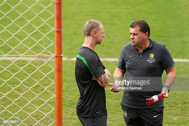Socceroos coach Ange Postecoglou talks to Socceroos football advisor Craig Moore during an Australian Socceroos training session at Arena Unimed...