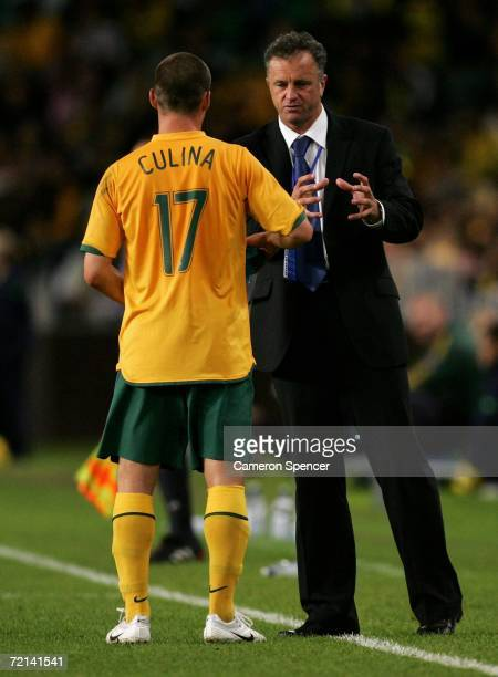 Socceroos coach Graham Arnold talks tactics with Jason Culina of the Socceroos during the Asian Football Confederation Asian Cup 2007 qualifying...