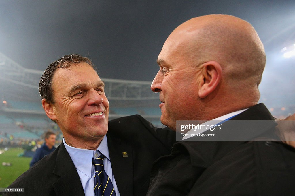 Socceroos coach Holger Osieck is congratulated by commentator Andy Harper during the FIFA 2014 World Cup Asian Qualifier match between the Australian Socceroos and Iraq at ANZ Stadium on June 18, 2013 in Sydney, Australia.