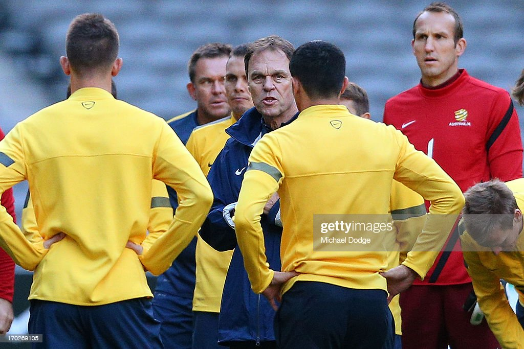 Socceroos coach <a gi-track='captionPersonalityLinkClicked' href=/galleries/search?phrase=Holger+Osieck&family=editorial&specificpeople=579862 ng-click='$event.stopPropagation()'>Holger Osieck</a> speaks to his players during an Australian Socceroos training session at Etihad Stadium on June 10, 2013 in Melbourne, Australia.