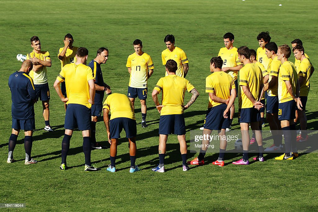 Socceroos coach <a gi-track='captionPersonalityLinkClicked' href=/galleries/search?phrase=Holger+Osieck&family=editorial&specificpeople=579862 ng-click='$event.stopPropagation()'>Holger Osieck</a> speaks to players during an Australian Socceroos training session at Macquarie Uni on March 20, 2013 in Sydney, Australia.