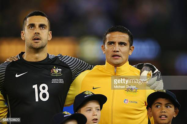 Socceroos goalkeeper Adam Federici and Tim Cahill sing the national anthem during the International Friendly match between the Australian Socceroos...
