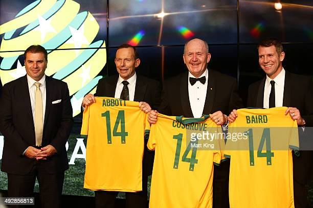 Socceroos Head Coach Ange Postecoglou presents Socceroos jerseys to Prime Minister of Australia Tony Abbott GovernorGeneral of Australia Peter...