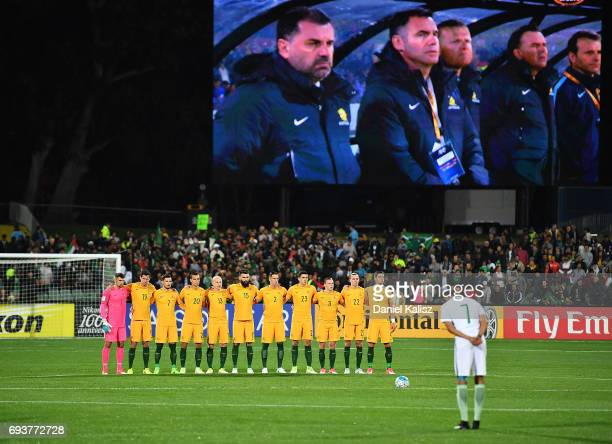 Socceroos players observe a minutes silence prior to the 2018 FIFA World Cup Qualifier match between the Australian Socceroos and Saudi Arabia at the...