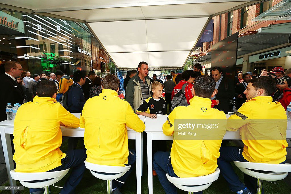 Socceroos players sign autographs for fans during an Australian Socceroos public appearance at Westfield Sydney on November 12, 2013 in Sydney, Australia.