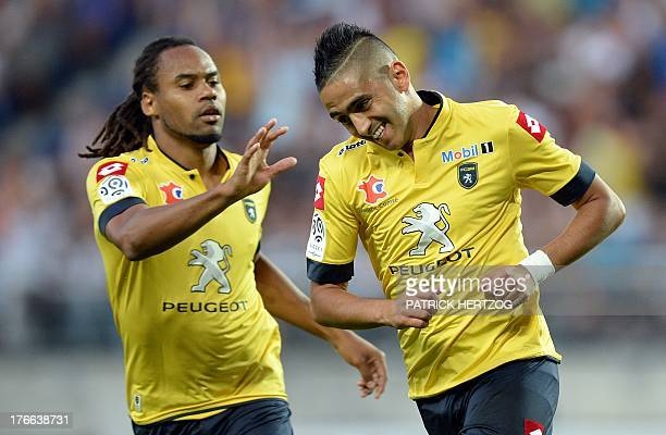 Sochaux Algerian midfielder Ryad Boudebouz celebrates with teammate Tunisian defender Yassin Mikari after scoring a goal during the French L1...