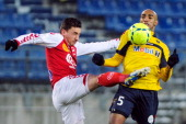 Sochaux' Brazilian midfielder Carlos Alberto Carlao vies for the ball with Reims' French midfielder Johan Ramare during the French L1 football match...