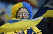 A Sochaux' fan with his face painted waits for the start of the French Cup semifinal football match between Sochaux and Marseille on April 20 at the...