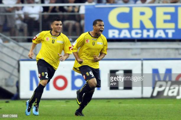 FC Sochaux' forward Charlie Davies reacts after scoring a goal during the French L1 football match Sochaux vs Bordeaux on August 15 2009 at the...