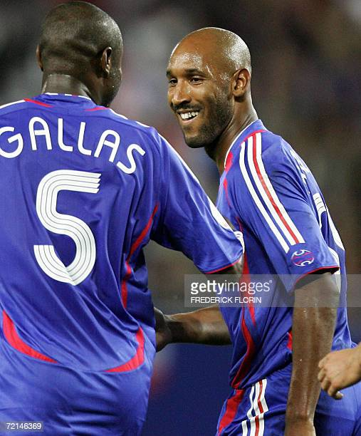 French forward Nicolas Anelka is congratulated by teammate William Gallas after scoring France's third goal during the Euro 2008 qualifying football...