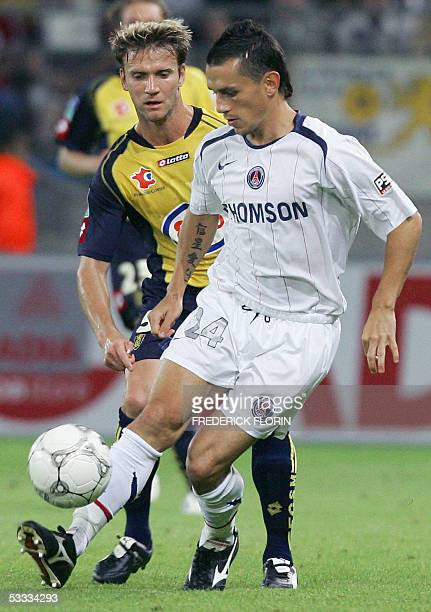Sochaux's French Philippe Brunel vies with Paris SaintGermain's midfielder Christophe Landrin during their French L1 football match 06 August 2005 at...