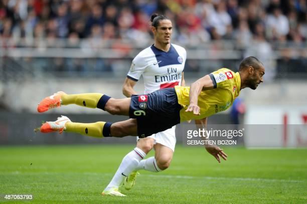 Sochaux' French and Malian defender Cedric Kante jumps for a header as Paris' Uruguayan forward Edinson Cavani looks on during the French L1 football...