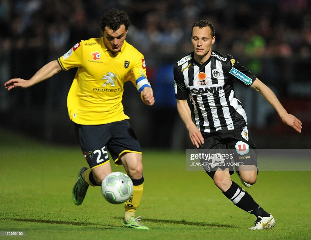Sochaux' French defender Julien Faussurier vies for the ball with Angers' French midfielder Vincent Manceau during the French L2 football match...