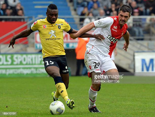 Sochaux' French defender Lionel Zouma vies with Monaco's French midfielder Jeremy Toulalan during the French L1 football match Sochaux vs AS Monaco...