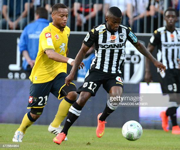Sochaux' French defender Marco Ilaimaharitra vies for the ball with Angers'Guinean midfielder Abdoul Razzagui Camara during the French L2 football...