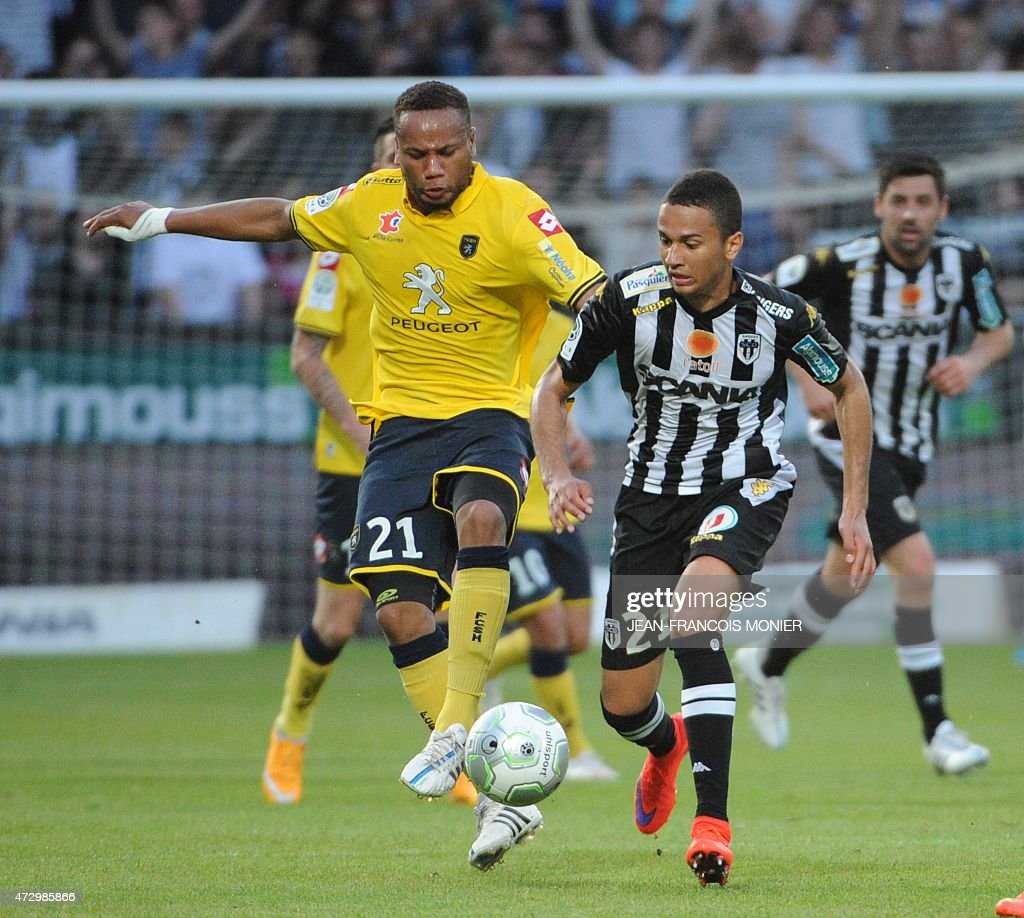 Sochaux' French defender Marco Ilaimaharitra vies for the ball with Angers' French midfielder Axel Ngando during the French L2 football match between...