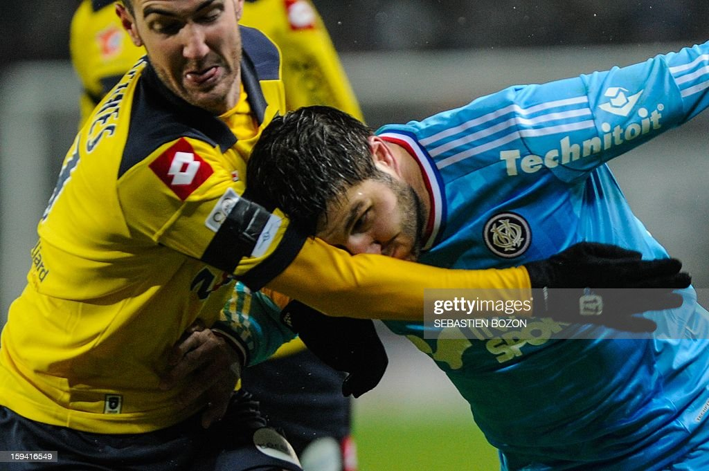 Sochaux' French defender Mathieu Peybernes (L) vies with Marseille's French midfielder Andre Pierre Gignac (R) during their French L1 football match Sochaux (FCSM) versus Marseille (OM) at the August Bonal Stadium in Montbeliard, on January 13, 2013