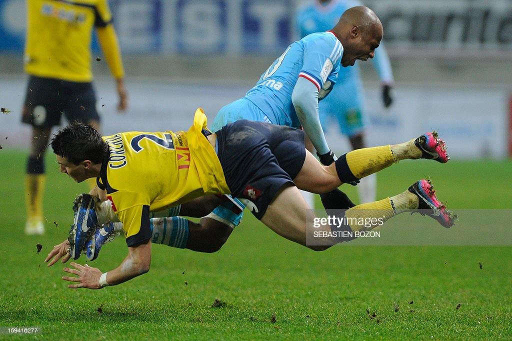 Sochaux' French defender Sebastien Corchia (L) vies with Marseille's Ghanaian forward Andre Ayew (R) during their French L1 football match Sochaux (FCSM) versus Marseille (OM) at the August Bonal Stadium in Montbeliard, on January 13, 2013AFP PHOTO / SEBASTIEN BOZON