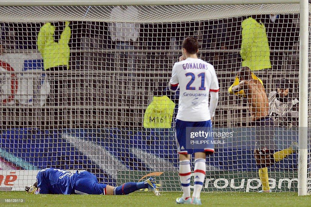 Sochaux' French forward Cedric Bakambu (R) celebrate after scoring during the French L1 football match Lyon vs Sochaux on March 31, 2013 at the Gerland stadium in Lyon, southeastern France.