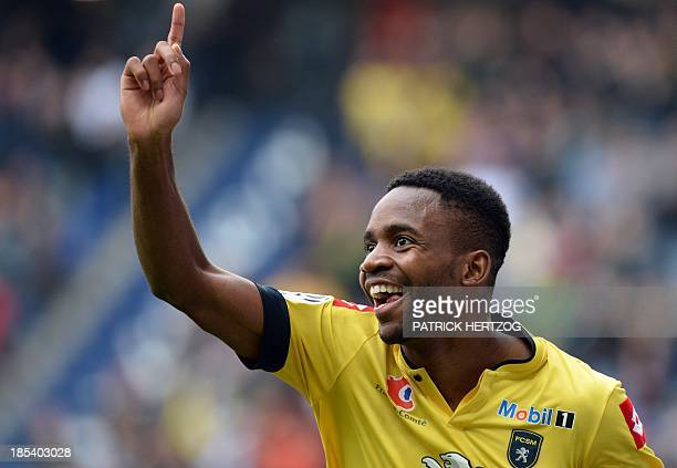 Sochaux' French forward Cedric Bakambu celebrates after scoring a goal during the French L1 football match Sochaux vs AS Monaco on October 20 2013 at...