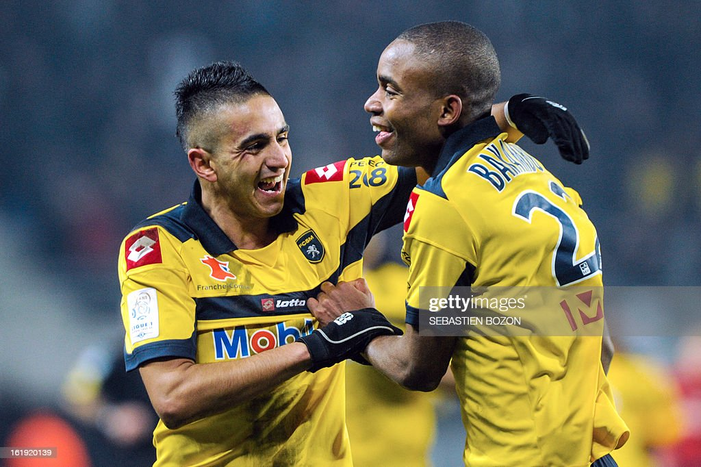 Sochaux' French forward Cedric Bakambu (R) is congratulated by Sochaux' Algerian midfielder Ryad Boudebouz (L) after scoring a goal during the French L1 football match Sochaux (FCSM) vs Paris (PSG) at the Auguste Bonal Stadium in Montbeliard on February 17, 2013.