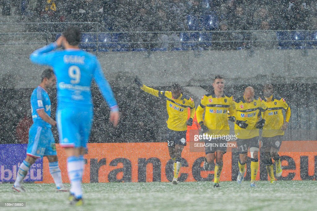 Sochaux' French forward Cedric Bakambu (C) jubilates after scoring a goal during their French L1 football match Sochaux (FCSM) versus Marseille (OM) at the August Bonal Stadium in Montbeliard, on January 13, 2013
