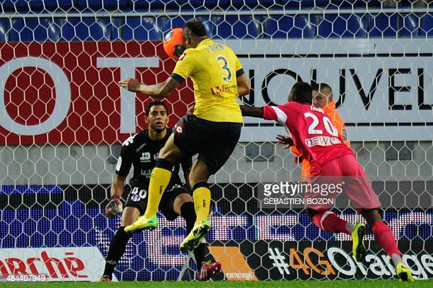 Sochaux' French forward Jordan Ayew heads the ball and scores a goal past Toulouse's French Goalkeeper Zacharie Boucher during the French L1 football...