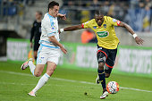 Sochaux' French forward Karl Toko Ekambi vies with Marseille's Spanish defender Javier Manquillo during the French Cup semifinal football match...