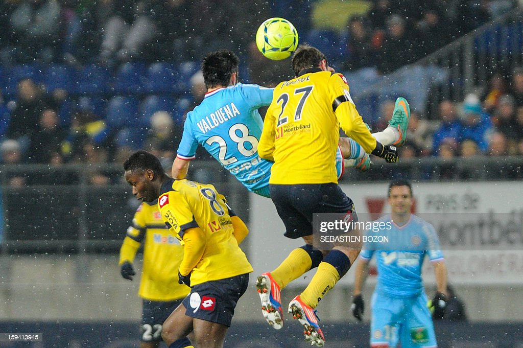 Sochaux' French midfielder Loic Poujol (R) vies with Marseille's French midfielder Mathieu Valbuena (C) during their French L1 football match Sochaux (FCSM) versus Marseille (OM) at the August Bonal Stadium in Montbeliard, on January 13, 2013.