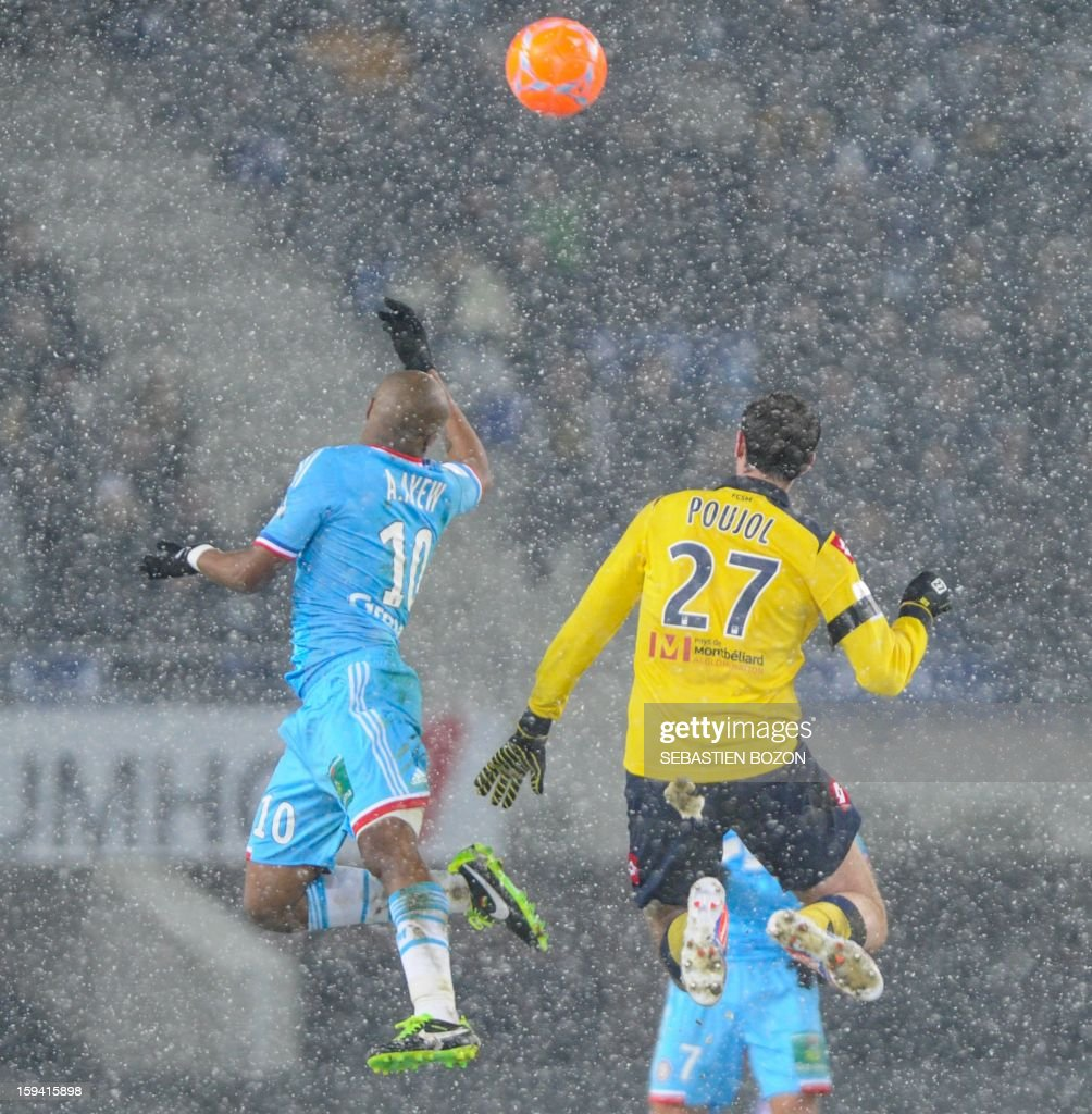 Sochaux' French midfielder Loic Poujol (R) vies with Marseille's Ghanaian forward Andre Ayew (L) during their French L1 football match Sochaux (FCSM) versus Marseille (OM) at the August Bonal Stadium in Montbeliard, on January 13, 2013
