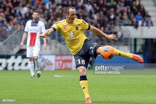 Sochaux' French midfielder Sebastien Roudet shoots as Paris' Italian midfielder Thiago Motta looks on during the French L1 football match Sochaux vs...