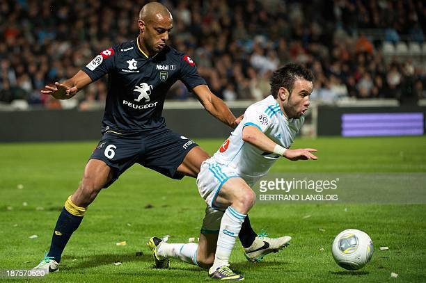 Sochaux' Malian defender Cedric Kante vies with Marseille's French midfielder Mathieu Valbuena during the French L1 football match between Olympique...