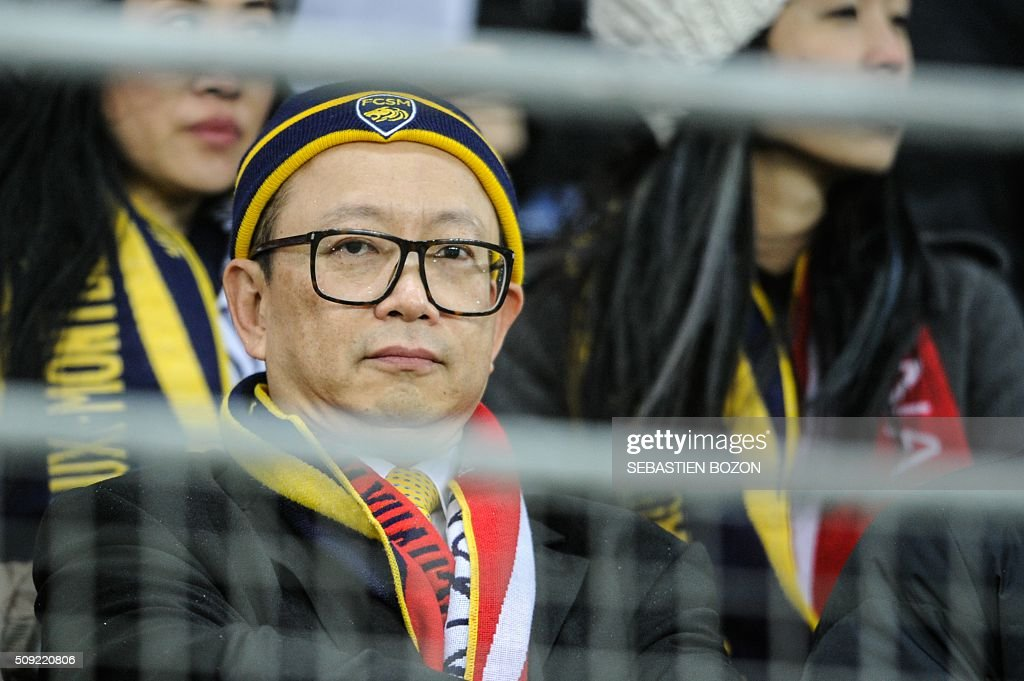 Sochaux' owner, Li Wing-Sang looks at the French cup round of 8 football match between Sochaux (FCSM) and Monaco (ASM) at the Auguste Bonal Stadium in Montbeliard, on February 9, 2016. / AFP / SEBASTIEN BOZON
