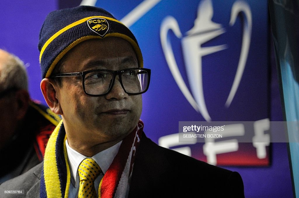 Sochaux' owner, Li Wing-Sang waits before the French cup round of 8 football match between Sochaux (FCSM) and Monaco (ASM) at the Auguste Bonal Stadium in Montbeliard, on February 9, 2016. / AFP / SEBASTIEN BOZON