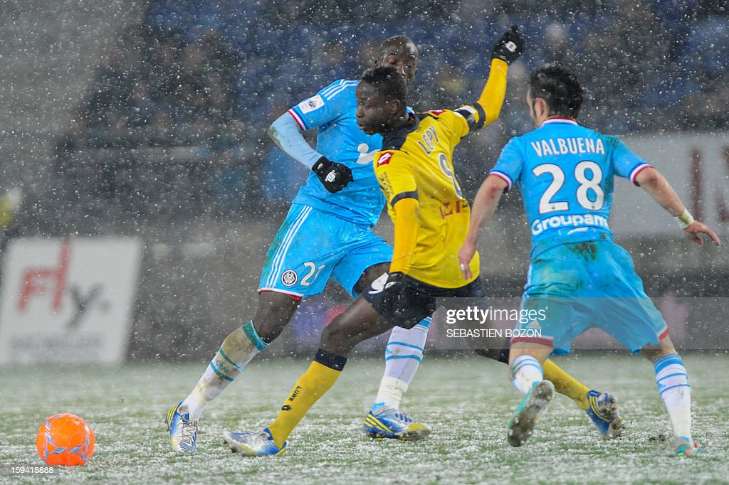 Sochaux' Senegalese midfielder Joseph Lopy (2nd R) vies with Marseille's Senegalese defender Souleymane Diawara (C) and Marseille's French midfielder Mathieu Valbuena (R) during their French L1 football match Sochaux (FCSM) versus Marseille (OM) at the August Bonal Stadium in Montbeliard, on January 13, 2013