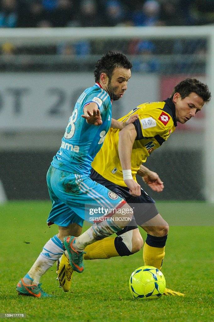 Sochaux's defender Sebastien Corchia (R) vies with Marseille's Mathieu Valbuena (L) during the French L1 football match Sochaux (FCSM) vs Marseille (OM) at the August Bonal Stadium in Montbeliard, on January 13, 2013.
