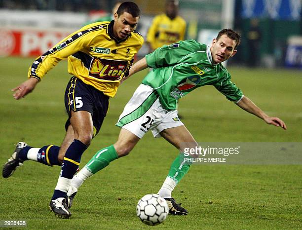 Sochaux's defender Sylvain Monsoreau vies with SaintEtienne's forward Lilian Compan during their French League cup semifinal match at the Geoffroy...