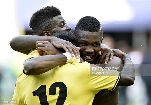 Sochaux's forward Marcus Thuram son of French football legend Lilian Thuram celebrates with teammates his victory against Lyon during the French...