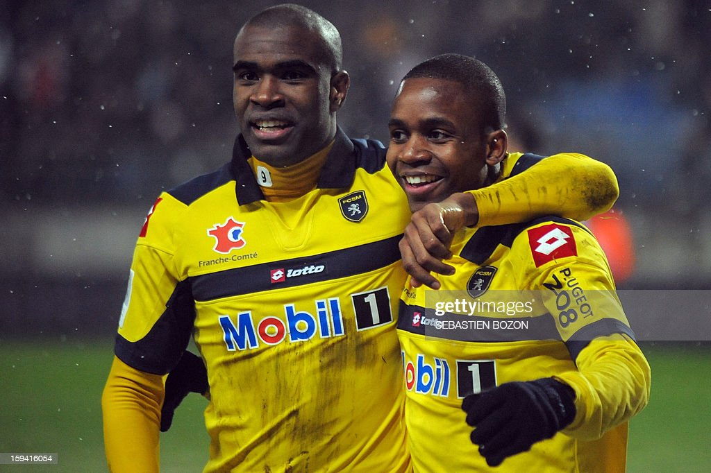 Sochaux's forward Sloan Privat (L) congratulates Sochaux's forward Cedric Bakambu by (L) after he scored a goal during their French L1 football match Sochaux (FCSM) vs Marseille (OM) at the August Bonal Stadium in Montbeliard, on January 13, 2013. AFP PHOTO / SEBASTIEN BOZON