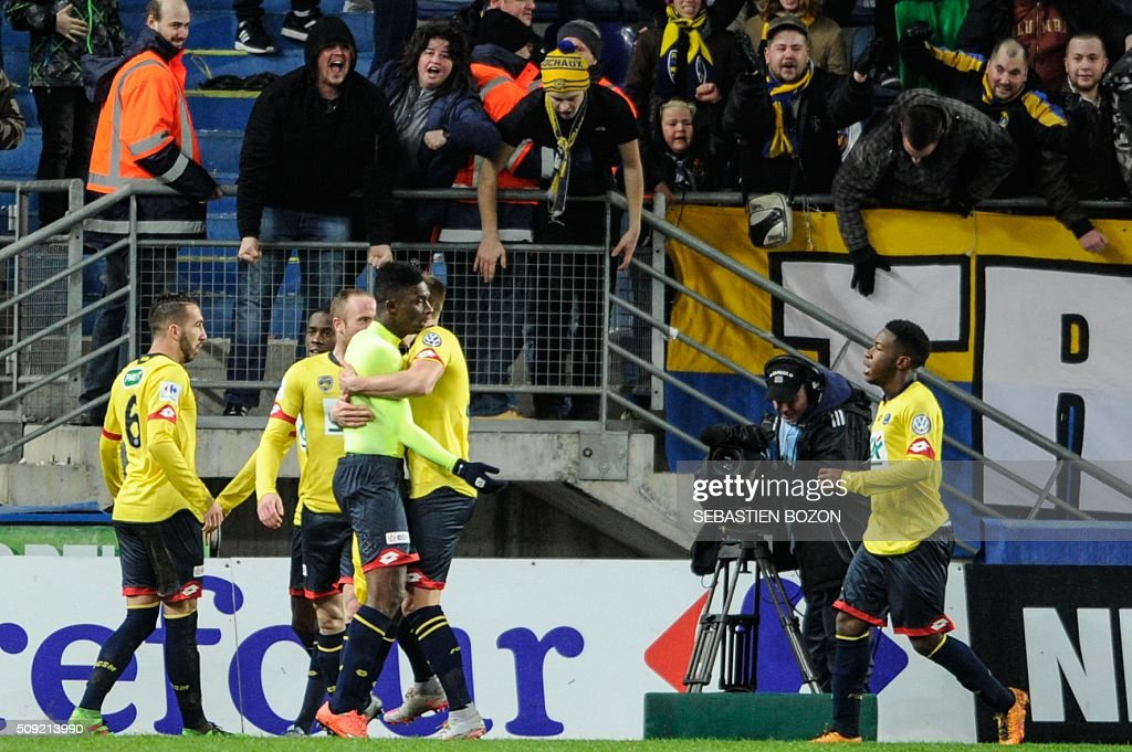 Sochaux' French forward Hadji Sacko (3rd L) celebrates with teammates after scoring a goal during the French Cup football match between Sochaux (FCSM) and Monaco (ASM) at Auguste Bonal Stadium in Montbeliard on February 9, 2016. / AFP / SEBASTIEN BOZON