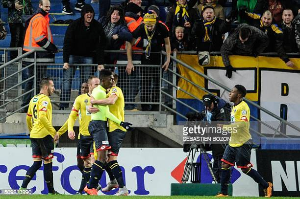 Sochaux's French forward Hadji Sacko celebrates with teammates after scoring a goal during the French Cup football match between Sochaux and Monaco...