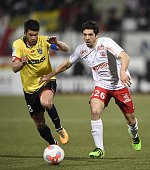 Sochaux's French midfielder Johann Ramare challenges Nancy's French defender Vincent Muratori during the French L2 football match between Nancy and...