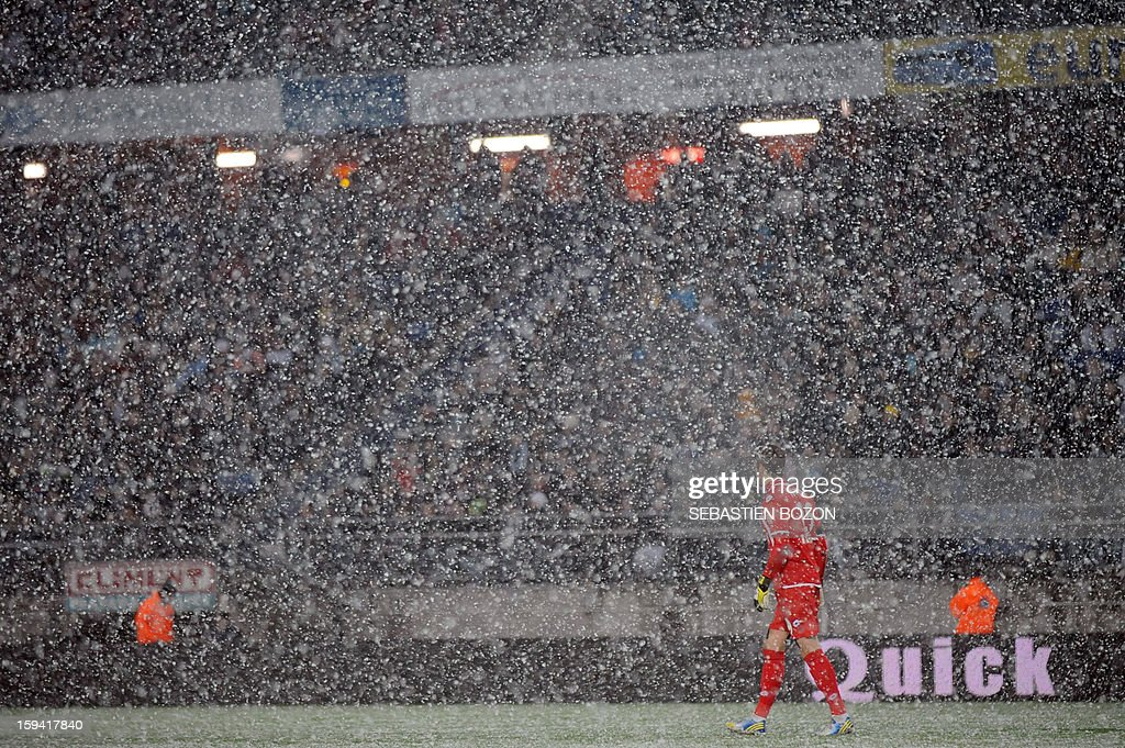 Sochaux's goalkeeper Simon Pouplin walks through the snow during the French L1 football match Sochaux (FCSM) vs Marseille (OM) at the August Bonal Stadium in Montbeliard, on January 13, 2013.