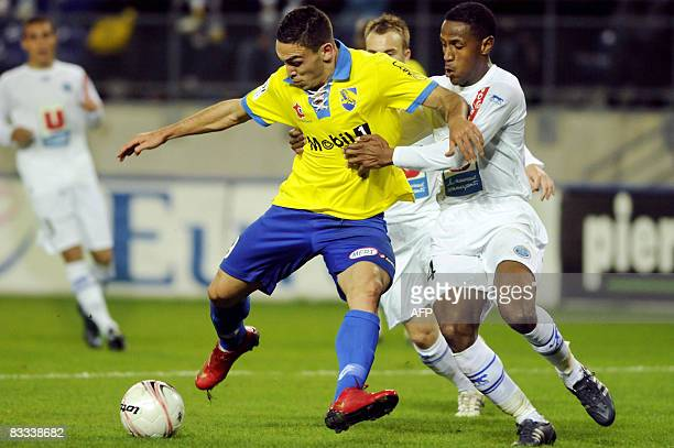 Sochaux's Turkish forward Mevlut Erding vies with Le Havre's Senegalese defender Massamba Lo Sambou during the French L1 football match Sochaux vs Le...