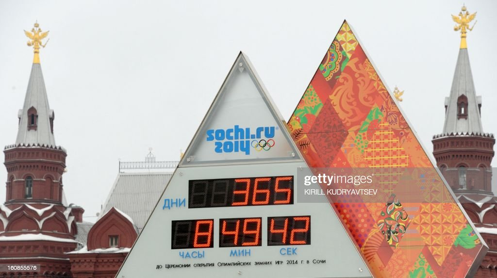 Sochi 2014 countdown clock rises in front of the State Historical Museum just outside the Kremlin in Moscow, on February 7, 2013. The clock screens (clockwise from top L) read: days, hours, minutes, seconds. A clock that will count down time to the Winter Olympics in Sochi were unveiled today in Moscow.