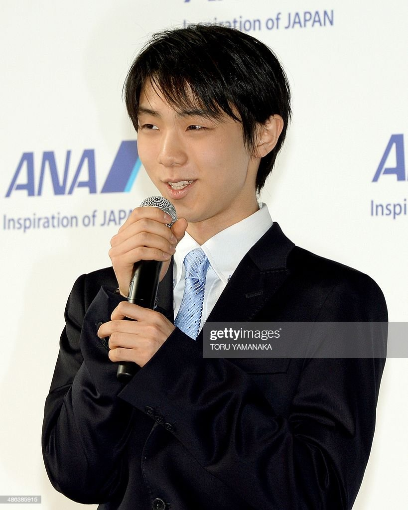 Sochi Olympic filgure skating gold medalist Yuzuru Hanyu of Japan answers questions during an event to unveil new uniforms of All Nippon Airways (ANA) at its hanger of Haneda Airport in Tokyo on April 24, 2014. AFP PHOTO/Toru YAMANAKA
